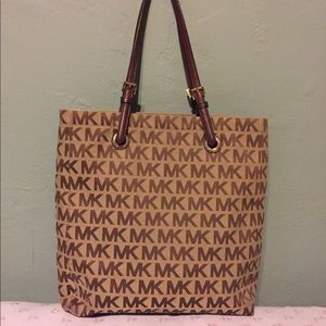 Don't want: Micheal Kors BAG.
